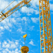 Crane against blue sky — Stock Photo
