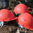 Stock Photo: Three mountain defensive helmets