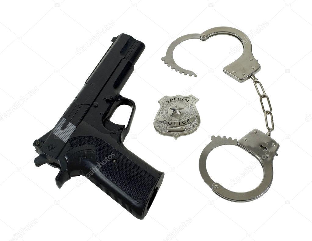 Policía Insignia Pistola Y Esposas