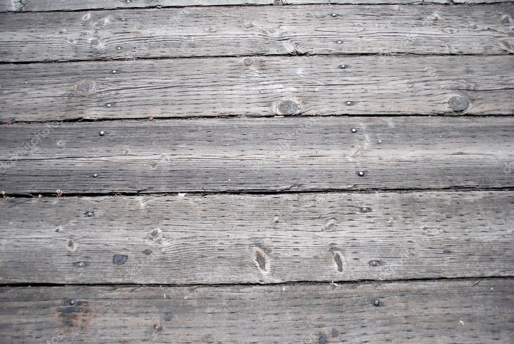 Weatherbeaten wooden walkway laid out in planks in a wooden texture  Stock Photo #7127942