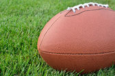 Close-up of an American Football on Grass Field — Stock Photo