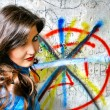 Girl near a graffiti — Stock Photo