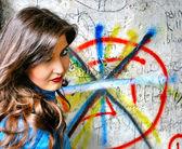 Girl near a graffiti — Stock Photo