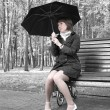 Girl with an umbrella - Stock Photo