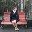 Girl on a bench - Stock Photo