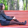 Girl sitting on the bench — 图库照片