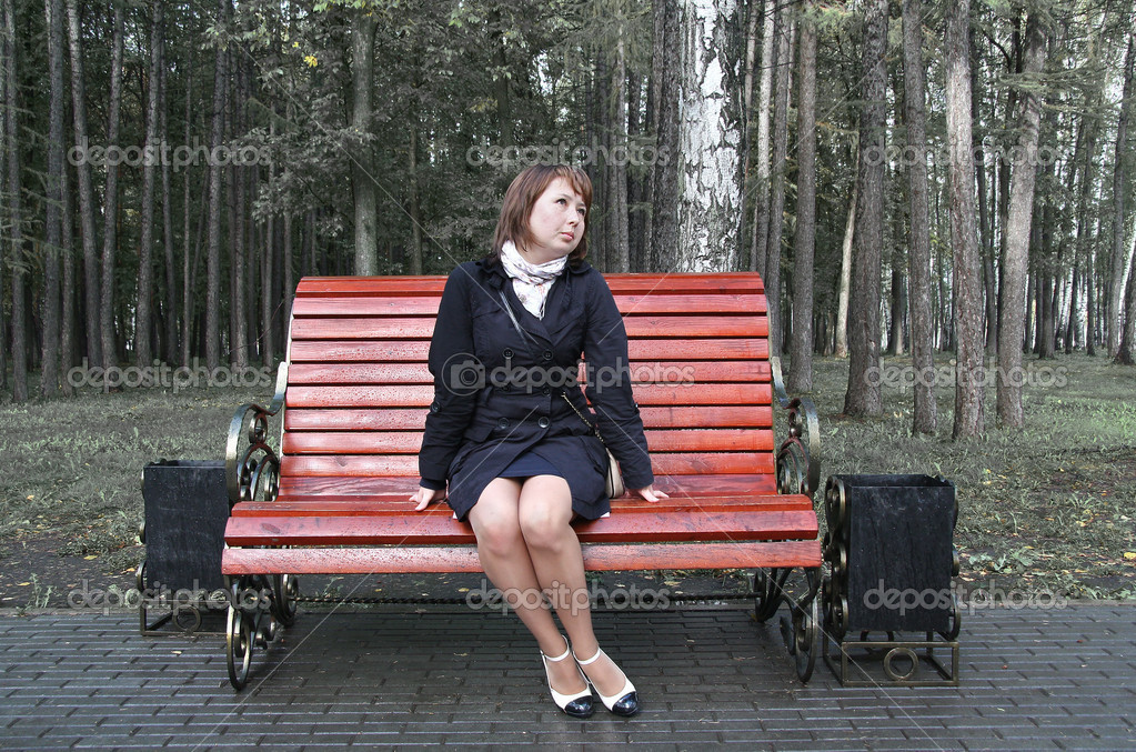 Girl sitting on a bench — Stock Photo #6952518