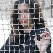 Girl behind the net — Stock Photo #6964729