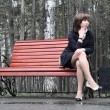 Girl on the bench — Stock Photo