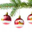 Red christmas ball on branch - Stockfoto