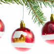 Red christmas ball on branch — Stock Photo #7656490