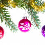 Christmas balls on spruce branch — Stock Photo