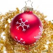 Christmas ball with snowflake symbols and tinsel — Stock Photo