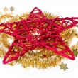 Red christmas star with golden tinsel - Stock Photo