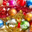 Christmas balls and tinsel — Stock Photo