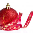 Red christmas ball with ribbon - Stockfoto