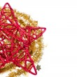 Red christmas star with golden tinsel - Stockfoto