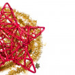 Red christmas star with golden tinsel — Zdjęcie stockowe
