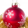 Christmas ball with snowflake symbols and tinsel - Stock Photo
