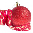 Red christmas ball with ribbon — Stock Photo #7657247