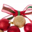 Christmas balls with big ribbon around - Stockfoto