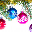 Christmas balls on spruce branch — Stock Photo