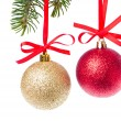 Christmas balls hanging from tree - Stock Photo