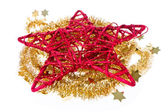Red christmas star with golden tinsel — Stock Photo