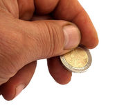Hand with a two euro-coin isolated on white — Stock Photo