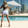 Blond rooftop poolside — Stock Photo #6752133