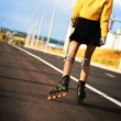 Stock Photo: Young womrollerskating during sunny day.