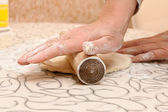 Unrolling a dough — Stock Photo