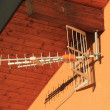 Antenna on house wall - Stock Photo