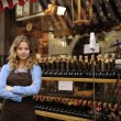 Store owner in front of shop - Stock Photo
