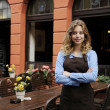 Waitress in front of restaurant - Stock Photo