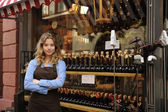 Store owner in front of shop — Stock Photo