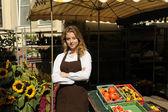 Vendor at the farmers market — Stock Photo