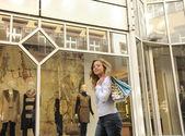 Happy woman doing shopping — Stock Photo