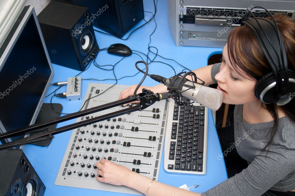 A radio DJ announces news in a studio — Stock Photo #6904457