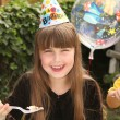 Stock Photo: Little Girl Celebrating Her Birthday