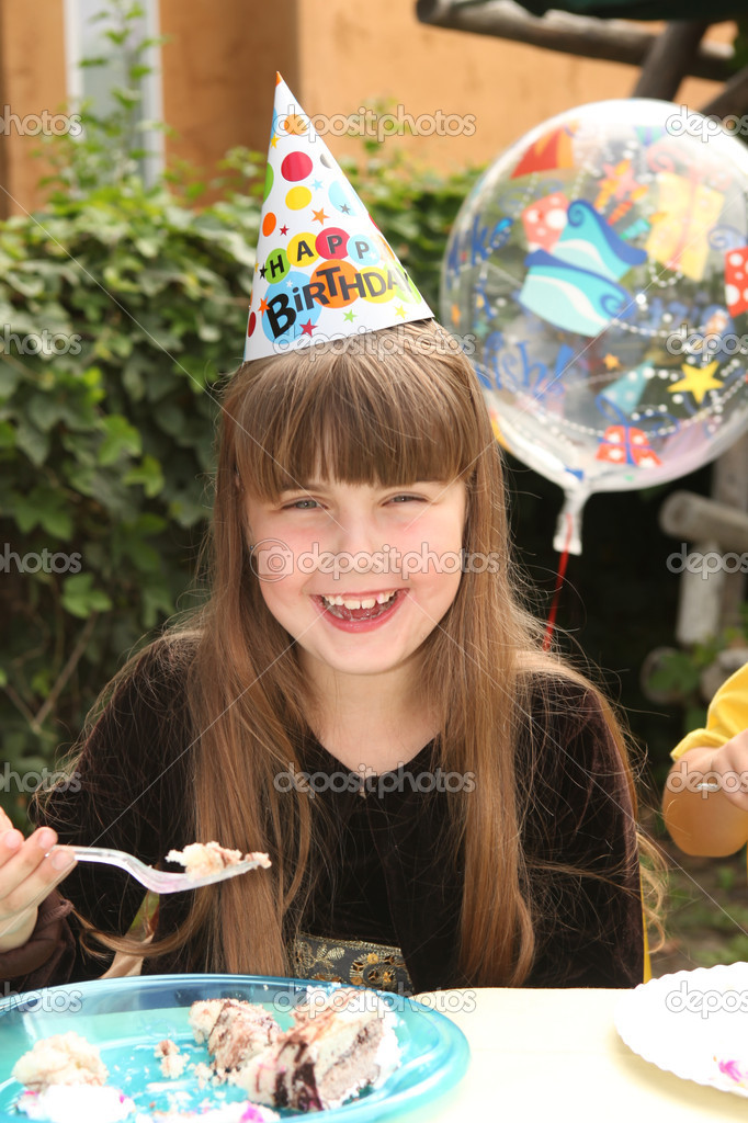 Happy Young Girl Celebrating Her Birthday by Eating Cake  Stock Photo #7140820