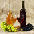 Royalty-Free Stock Photo: Wine and grapes on vintage background