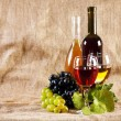 Wine and grapes on vintage background — Stock Photo #7403776