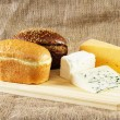 Bread and cheese on cloth background — Stock Photo #7411978