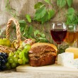 Wine and grapes on vintage background — Stock Photo