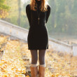 Young beautiful lady in an autumn park - Stock Photo