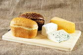 Bread and cheese on cloth background — Stock Photo