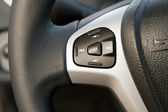 Audio control knob on steering wheel — Stock Photo