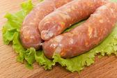 Three raw sausage — Stock Photo
