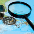 Compass and magnifying glass - Stok fotoğraf